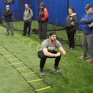 Coach James shares some agility workouts with D1 Little League coaches